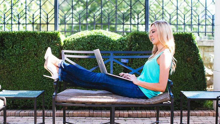 Woman blogging on laptop